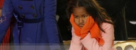 Sasha Obama, younger daughter of U.S. President Barack Obama, watches inaugural parade in Washington