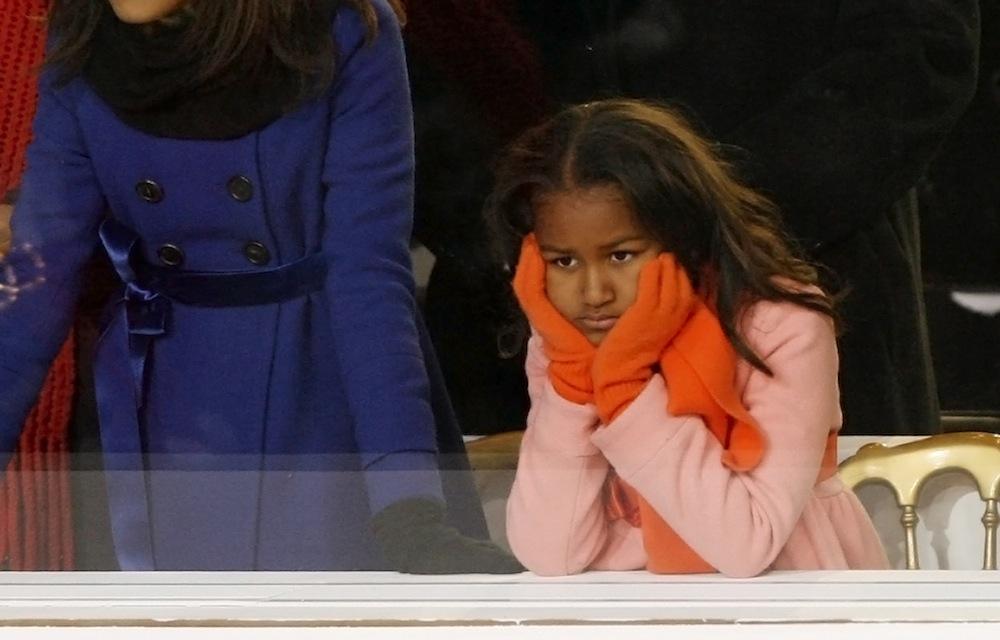 Sasha Obama, younger daughter of U.S. President Barack Obama, watches inaugural parade in Washington