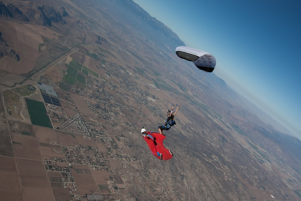 """Weiss flying with high-performance canopy pilot Jessica Edgeington in a discipline the author pioneered called XRW (""""Extreme Relative Work""""). Advances in skill and technology have allowed a wingsuit flyer in freefall to match speeds with a pilot under a fully open parachute."""
