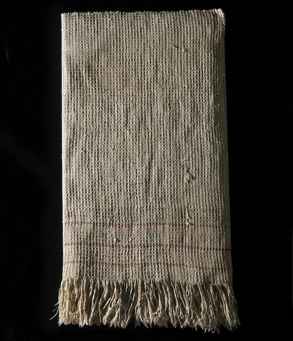 Captain R. M. Sims purchased this towel in Richmond just days before the Army of Northern Virginia was forced to abandon the Confederate capital. On April 9, 1865, he now used it as a flag of truce. After the Union's Lt. Colonel Edward Whitaker escorted Simms back to the Confederate lines, he asked to keep the towel for his own protection as he returned to Union lines. Whitaker cut the towel in two. He kept one half and presented the other to General Custer's wife, Elizabeth, who later bequeathed it to the Smithsonian.
