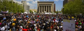 People gather at city hall in Baltimore, Maryland May 2, 2015. A jubilant Baltimore headed into a weekend of rallies after six police officers were criminally charged over the arrest of 25-year-old black man Freddie Gray whose death led to rioting earlier in the week. REUTERS/Eric Thayer      TPX IMAGES OF THE DAY      - RTX1B9JL