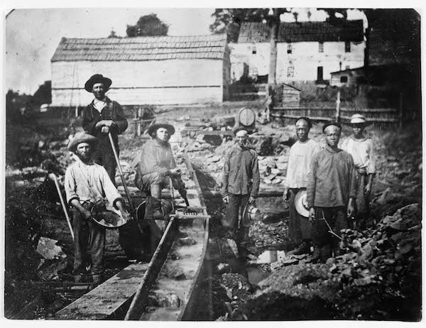 Chinese miners work alongside miners of other ethnicities in Auburn, California, circa 1852. Fortune-seekers from around the world migrated to northern California following the discovery of gold in 1848.