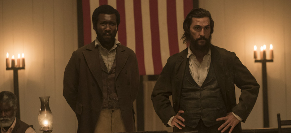 At a meeting of the Union League, Moses (Mahershala Ali) and Newt (Matthew McConaughey) tell the Freedman that all citizens shall have the right to vote.