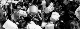 """Vietnamese """"boat people"""" aboard the refugee ship """"Tung An"""" hold out pails and cans to crewmen of a Philippine Navy ship that docked alongside the vessel February 21,1979 with a fresh supply of drinking water. The refugees have been stranded aboard the Tung An in Manila Bay for eight weeks. (AP Photo)"""