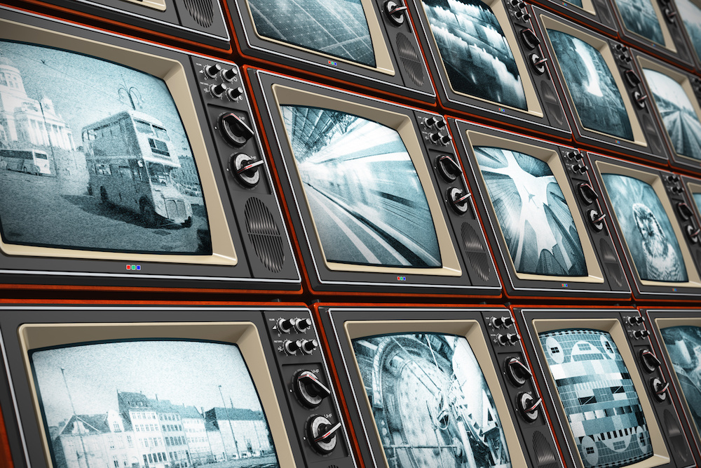 Creative abstract television broadcasting, news media, business, entertainment and cinema concept: wall of old wooden black and white TV screens with various broadcast channels