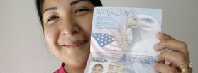 Anna Karen Ramirez, 19, poses with her passport at her home in Alamo, Texas in 2009. Photo by Eric Gay/Associated Press.