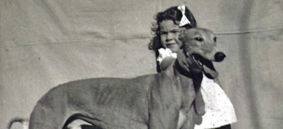 Author Claudette Sutherland, with one of her family's racing greyhounds. As a young child during the Second World War, Sutherland grew up on the road, traveling from track to track. Photo courtesy of Claudette Sutherland.