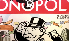 Detail from the cover of a recent version of Monopoly. Photo by Sara Catania.