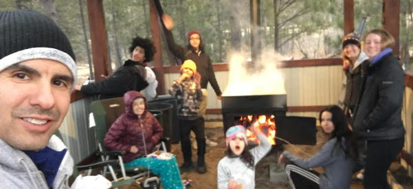 All in the family: The Treuer clan, boiling maple syrup. From left: Anton Treuer, Margaret Treuer, Robert Treuer, Caleb Treuer, Evan Treuer, Blair Treuer, Elias Treuer, Luella Treuer, Margret Krueger. Photo courtesy of Anton Treuer.