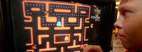 A youth tries a Ms. Pac-Man TV game in New York, in October 2004. Photo by Richard Drew/Associated Press.