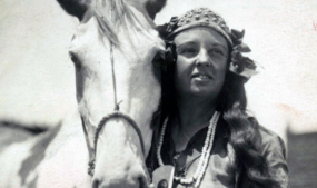"Lillian as Princess Wenona, with beloved horse ""Rabbit."" This was probably taken around 1915, while she was contracted with the Miller Brothers 101 Ranch Wild West. Image courtesy of University of Oklahoma Libraries, Western History Collection, Nesbitt-Lenders Collection, No. 601."