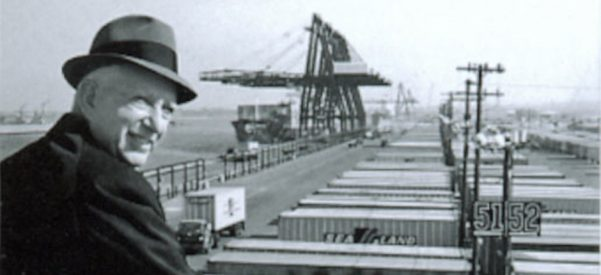 Shipping container entrepreneur Malcom McLean, standing at the railing at Port Newark, 1957. Photo courtesy of Maersk Line/Wikimedia Commons.