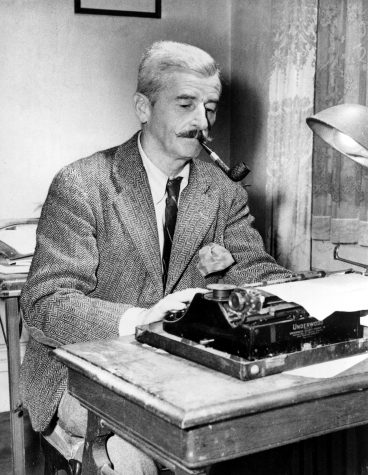 William Faulkner works at his Underwood typewriter in his study at his Rowan Oaks home near Oxford, Mississippi. Photo courtesy of Associated Press.