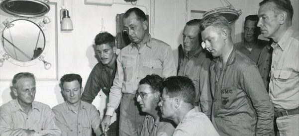 Major General Cates with War Correspondents Aboard Ship, Febraury 1945. Photo courtesy of USMC Archives/Flickr.