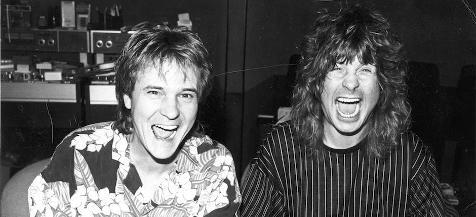 Grammy Award-winning producer Keith Olsen mugs for the camera behind the mixing console with client and pal Ozzy Osbourne in 1988 inside Olsen's Goodnight L.A. recording studio as the pair work on Osbourne's upcoming album, No Rest for the Wicked. Photo courtesy of Keith Olsen.