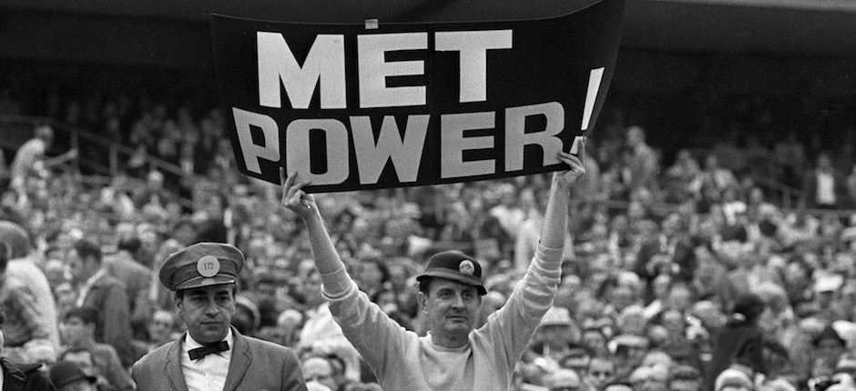 """Karl Ehrhardt, the New York Mets fan known as the Sign Man, holds up a """"Met Power"""" sign after Ed Kranepool hit a World Series Game 3 home run, Oct. 14, 1969. Photo courtesy of Associated Press."""
