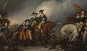 In this painting of the Capture of the Hessians at Trenton, Gen. Henry Knox stands by the left shoulder of Major General Nathanael Greene, who is seated on the white horse at right. Image courtesy of Yale University Art Gallery/Wikimedia Commons.